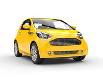 Small Yellow Compact Car - Front Headlight View Stock Photos