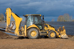 Small yellow excavator Stock Photos
