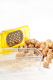 Small yellow grater with a bunch of hazelnuts Stock Photography