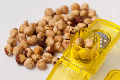Small yellow grater with a bunch of hazelnuts Royalty Free Stock Photo