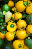 Small yellow and green squash at the market stock photos