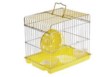 Small Yellow Hamster Cage. A yellow running wheel in a small yellow hamster cage Royalty Free Stock Photos