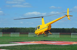 Small yellow helicopter Stock Images