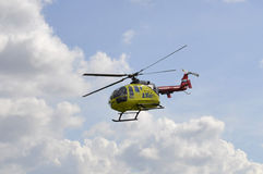 The small yellow helicopter of Utair airline in the sky. Royalty Free Stock Photos