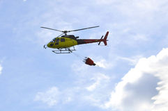 The small yellow helicopter of Utair airline in the sky. Stock Photo