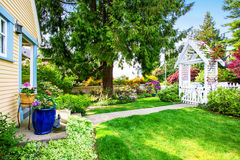 Small Yellow house exterior with White picket fence. And Decorative Gate. Northwest,USA Royalty Free Stock Photography