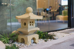 Small yellow japanese stone pavilion Stock Photography