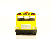 Small yellow machine cartoon school bus Stock Photos