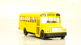 Small yellow machine cartoon school bus Royalty Free Stock Photography