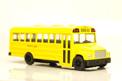 Small yellow machine cartoon school bus Stock Photography