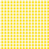 Small yellow patterned fabric with checks Stock Images