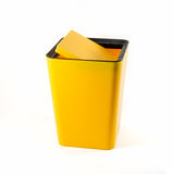 Small yellow plastic bin isolated Stock Image