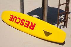 Small yellow rescue boat on the beach Royalty Free Stock Image