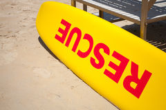 Small yellow rescue boat on sandy beach Stock Images