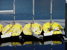 Small Yellow Sail Boats Sitting On Dock Royalty Free Stock Image