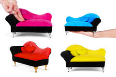 Small yellow sofa over white background set Royalty Free Stock Image