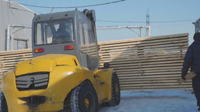Small yellow truck drove to the hangar and ship glulam. stock video footage