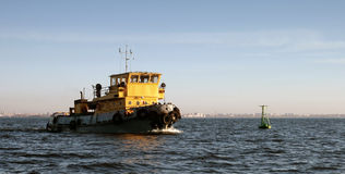 Small yellow tugboat. Small Tugboat with yellow superstructure in Gulf of Finland, Russia, Saint-Petersburg Stock Photography