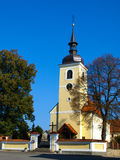 Small yellow village church Stock Photo