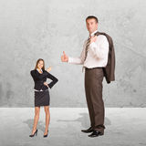 Small Young Businesswoman and Large Businessman Royalty Free Stock Photos