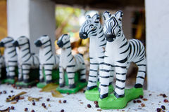 Small zebra statues for pray the god. Stock Photos