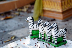 Small zebra statues for pray the god. Royalty Free Stock Image
