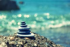 Stone balance. A small Zen out of a pile of stones on a rock,Stone balance Royalty Free Stock Images
