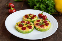 Small zucchini pizza on the circles with pepperoni and mozzarella. Stock Photography