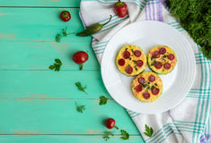 Small zucchini pizza on the circles with pepperoni and mozzarella. Stock Photo