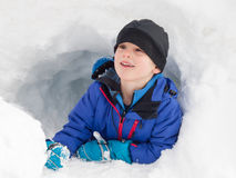 Smallboy playing in snow Royalty Free Stock Photo