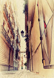 Smalle Spaanse straat. Foto in oud Royalty-vrije Stock Afbeeldingen