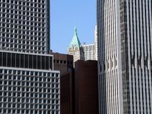 Smaller building between two skyscrapers in lower Manhattan, New York City, USA Stock Photos