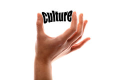 Smaller culture. Color horizontal shot of a of a hand squeezing the word culture Stock Photography