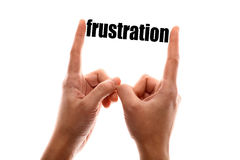 Smaller frustration. Color horizontal shot of a of two hands squeezing the word frustration Stock Photos