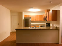 Kitchen area with granite counters and new cabinets Royalty Free Stock Photography