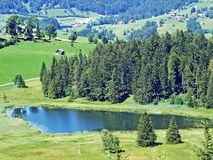The smaller lake Schwendisee Hinter Schwendisee, Wildhaus. Canton of St. Gallen, Switzerland stock photography