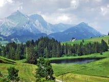 The smaller lake Schwendisee Hinterer Schwendisee, Wildhaus. Canton of St. Gallen, Switzerland stock photography