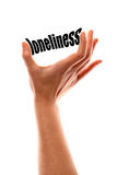Smaller loneliness concept. Color vertical shot of a of a hand squeezing the word loneliness Stock Photos