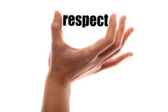 Smaller respect. Color horizontal shot of a of a hand squeezing the word respect royalty free stock photography