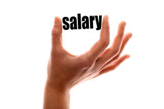 Smaller salary. Color horizontal shot of a of a hand squeezing the word salary Royalty Free Stock Image