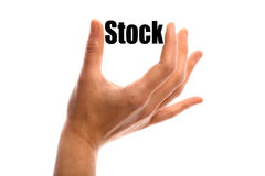 Smaller stock. Horizontal shot of a hand holding the word Stock between two fingers, isolated on white Stock Photography