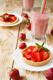 Smaller Tart with custard and strawberries Stock Images