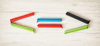 Smaller-than, greater-than and equal sign of colorful bag clips Royalty Free Stock Photography