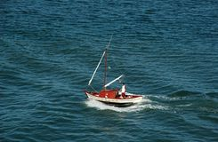 Smallest Boat Ever. Splendid sea and a little boat sailing Stock Photos