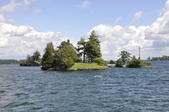 Smallest Bridge between Border USA and Canada from Thousand Islands Archipelago. Landscape from Ontario province in Canada on 25th June 2017 royalty free stock photos
