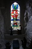Smallest Church. Stained-glass window in the smallest church in Ireland, located in Portbradden, Co. Antrim, Northern Ireland Stock Image