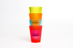 Smalll colorful plastic glasses. Small colorful plastic glasses isolated on white Royalty Free Stock Image