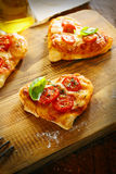 Smalll heart shaped pizzas Royalty Free Stock Image