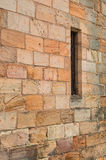 Smalt fönster för forntida vägg Royaltyfri Fotografi