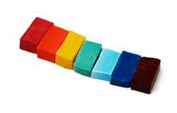 Smalt tiles of different colors arranged in rainbow order on whi Royalty Free Stock Images